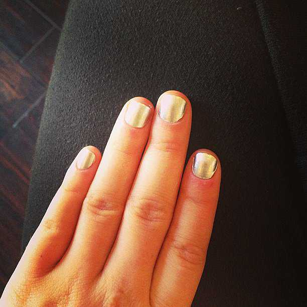 Lucy-Hale-painted-her-nails-up-Essie-Place-Like-Chrome